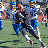 Photo - Jeffery Jones<br /> Gallup Josh Jones (9)) runs with the ball against the Bloomfield Bobcats during Saturday's JV match-up at Angelo DiPaulo Memorial Stadium in Gallup. The Bobcats won 48-8.