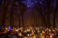 Evening on All Saints Day at Rakowicki Cemetery in Krakow, Poland 2019.