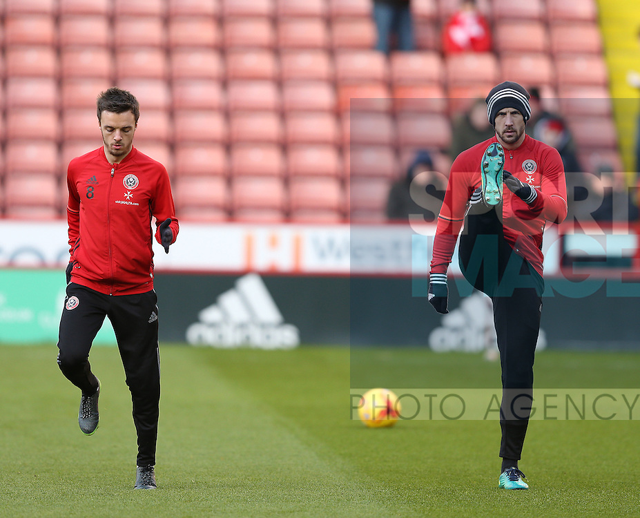 Stefan Scougall of Sheffield Utd and Jake Wright of Sheffield Utd  during the English League One match at Bramall Lane Stadium, Sheffield. Picture date: December 26th, 2016. Pic Simon Bellis/Sportimage