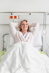 Patient in hospital lying in bed