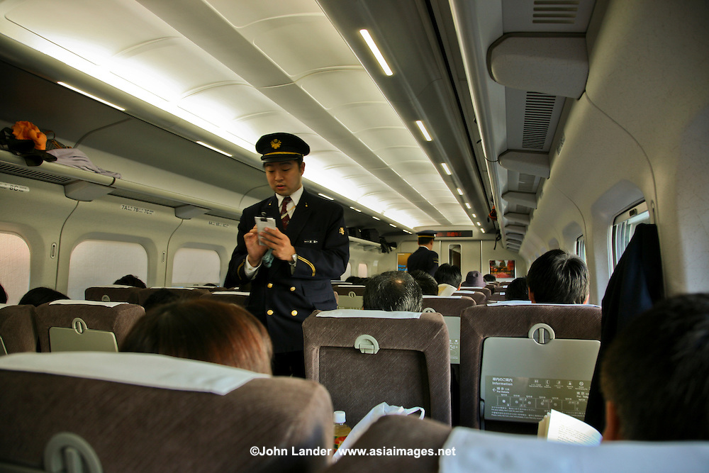 """Japan Railways Conductor - Japan's main island of Honshu is covered by a network of high speed train lines that connect Tokyo with most of the island's major cities. Japan's high speed  """"bullet trains"""" are known by the Japanese as the """"shinkansen"""" short for New Kansai Line."""