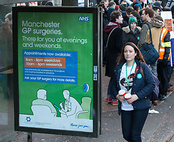 © Licensed to London News Pictures . 12/01/2016 . Manchester , UK . A poster at a bus stop advertising late night weekday and weekend GP services , adjacent to the picket . Junior doctors walk out to a picket outside the Manchester Royal Infirmary in England as the first of three planned strikes over pay and working conditions starts this morning (12th January 2016) at 8am . Photo credit : Joel Goodman/LNP
