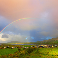 Dramatik Sunrise Sky over Cahersiveen with strong double Rainbow, County Kerry, Ireland / rb015