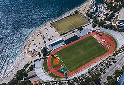 THEMENBILD - das alte Stadion Kantrida des HNK Rijeka mit seinem Trainingsplatz liegt direkt am Meer und grenzt an einem Badestrand und einem Yachthafen an, es ist ein Neubau an dieser Stelle geplant, aufgenommen am 14. August 2019 in Rijeka, Kroatien // the old stadium Kantrida of the HNK Rijeka with the training ground is situated directly at the coast and adjacent to a beach and a marina, a new stadium is planned at this location in Rijeka, Croatia on 2019/08/14. EXPA Pictures © 2019, PhotoCredit: EXPA/ JFK