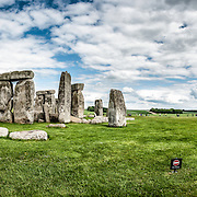 Stonehenge Panorama with Salisbury Plain. Believed to have been built somewhere between 2000 and 3000 BC, Stonehenge is one of the United Kingdom's most distinctive landmarks. It's function and purpose remains a matter of conjecture, although many theories have been offered. It consists of a series of large standing stones, some of which have toppled over the centuries. Stonehenge is located in Salisbury Plain west of London.