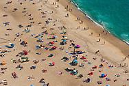Beachgoers in Nazare, Portugal.
