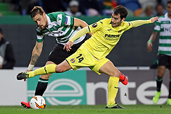 February 14, 2019 - Lisbon, Portugal - Sebastián Coates of Sporting CP (L) vies for the ball with Alfonso Pedraza of Villarreal FC (R) during the Europa League 2018/2019 footballl match between Sporting CP vs Villarreal FC. (Credit Image: © David Martins/SOPA Images via ZUMA Wire)