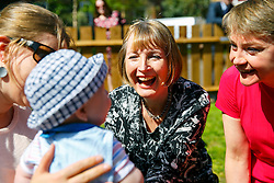 © Licensed to London News Pictures. 15/04/2015. LONDON, UK. Harriet Harman and Yvette Cooper meeting Janosch, 5 months old, whilst meeting mothers and children at Stockwell Gardens Nursery in south London to launch Labour's Women's Manifesto on Wednesday, 15 April 2015. Photo credit : Tolga Akmen/LNP