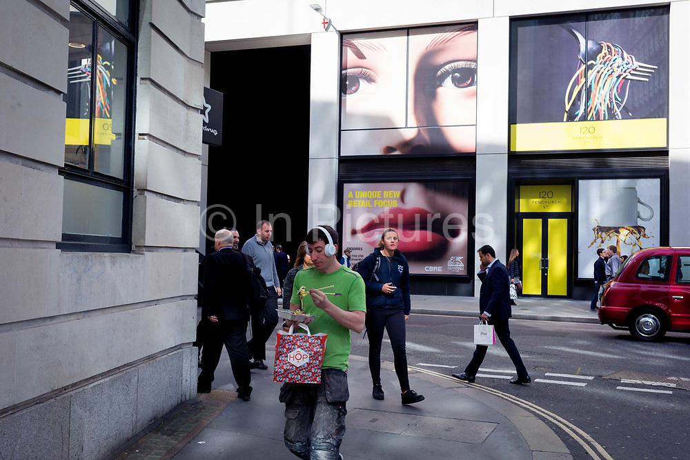 A pair of eyes and passers-by on Fenchurch Street - in the heart of the capitals financial district aka The Square Mile, on 24th September 2018, in London, England.