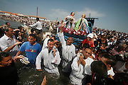 Gitan prilgrims carry the two Saint Marys 'Marie Salome and Marie Jacobe' cousins of Mary Magdalene during the Gypsy Pilgrimmage of Saintes Maries de la Mer<br /><br />Europe, France, Camargue, Saintes Maries de la Mer, Gypsy Pilgrimmage 'Pelerinage des Gitans aux Saintes Maries de la Mer'. Gypsies from all over the world come to celebrate their patron Saint Sara who is carried by them from the church to the sea-shore. May 24th and 25th every year