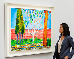 "© Licensed to London News Pictures. 30/09/2016. London, UK.  ""Guest House Wall"" by David Hockney (est. GBP1.8-2.5 million) is viewed by a staff member at the preview of Sotheby's London upcoming Contemporary Art Auctions.  Photo credit : Stephen Chung/LNP"