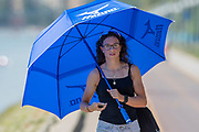 Plovdiv, Bulgaria, Saturday, 15th September 2018. Supporter, using her umbrella as a sun shade, FISA, World Rowing Championships,  © Peter SPURRIER,