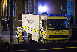 © Licensed to London News Pictures . 28/11/2013 . Manchester , UK . Army bomb disposal robot at the foot of the street . Scene at 17 Mellor Street in Eccles , Greater Manchester this evening (Thursday 28th November 2013) where police have cordoned off adjoining streets and evacuated houses following the discovery of a suspicious device .  Photo credit : Joel Goodman/LNP