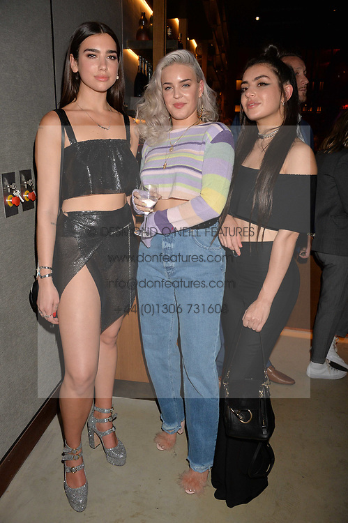 Dua Lipa, Anne-Marie and Charli XCX at the Warner Music Group and British GQ Summer Party in partnership with Quintessentially held at Nobu Shoreditch Willow Street, London England. 5 July 2017.<br /> Photo by Dominic O'Neill/SilverHub 0203 174 1069 sales@silverhubmedia.com