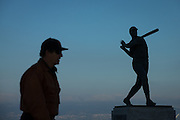 A San Francisco Giants fan walks past the Willie Mays statue in McCovey Cove before Game 3 of the NLDS against the Chicago Cubs at AT&T Park in San Francisco, Calif., on October 10, 2016. (Stan Olszewski/Special to S.F. Examiner)