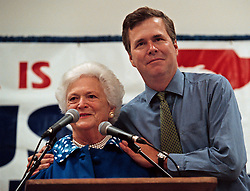 April 16, 2018 - (File Photo) - Former first lady Barbara Bush was reported in failing health and has decided not to seek further medical treatment, a family spokesman says. PICTURED: Oct 31, 2000 - Palm Harbor, Florida, U.S. - Florida Governor JEB BUSH, right, embraces his mother BARBARA BUSH after her speech to the crowd at the Palm Harbor Senior Activity Center. Barbara was stumping for her son George W. Bush in his race to become President. (Credit Image: © Scott Keeler/Tampa Bay Times/ZUMAPRESS.com)
