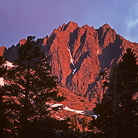 Dawn light illuminates Two Eagle Peak in the Palisade region of California's Sierra Nevada.