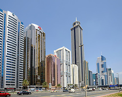 Daytime skyline view along skyscrapers on Sheikh Zayed Road in Dubai United Arab Emirates