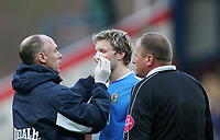 Photo. Andrew Unwin.<br /> Blackburn Rovers v Norwich, Barclays Premiership, Ewood Park, Blackburn 12/02/2005.<br /> Blackburn's captain, Andy Todd (C), receives treatment on a cut above his eye.