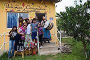 A group photograph of the children and helpers on their stilts outside the community library, Biblioteca Comunitaria do Arquipelago, Porte Alegre, Brazil. <br /> <br /> Once a week the children have a music and poetry session where they go out in to the community on stilts singing, playing music and reciting poetry.<br /> <br /> Cirandar is working in partnership with  C&A and C&A Instituto to implement a network of Community Libraries in eight communities of Porto Alegre.