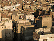 View from the roofs of the Walled City of Lahore. A boy does his homework.