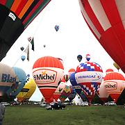 Hot Air balloons in the skies around rural Michigan near Battle Creek during the World Hot Air Ballooning Championships. Battle Creek, Michigan, USA. 19th August 2012. Photo Tim Clayton