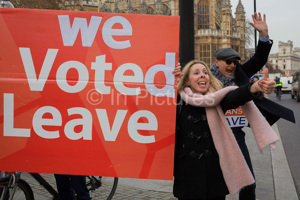 As Prime Minister Theresa May prepares to sell her Brexit deal ahead of five days of debate and eventual vote in parliament, Brexiteers shout at passing motorists outside the House of Commons, on 4th December 2018, in London, England. This week will be a vital step for May's Premiership and the UK's Brexit status.