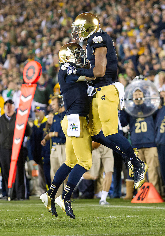 September 22, 2012:  Notre Dame wide receivers TJ Jones (7-right) and Robby Toma (9-left) celebrate reception during NCAA Football game action between the Notre Dame Fighting Irish and the Michigan Wolverines at Notre Dame Stadium in South Bend, Indiana.  Notre Dame defeated Michigan 13-6.