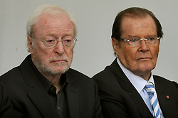 File photo dated 23/06/13 of Sir Michael Caine (left) and Sir Roger Moore at the Michael Winner memorial service at the National Police Memorial in The Mall, London. Sir Roger has died in Switzerland after a short battle with cancer, his family has announced.
