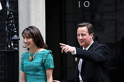 LOCATION, UK  29/04/2011. The Royal Wedding of HRH Prince William to Kate Middleton. .Prime Minister David Cameron and his wife Samantha Cameron leaving 10 Downing Street. .Photo credit should read CRAIG SHEPHEARD/LNP.