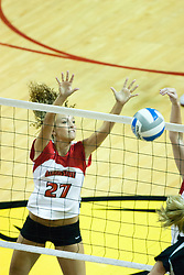 19 AUG 2006  Katie Seyller gets half a block. Northern Illinois Huskies got slammed by Illinois State Redbirds, losing the match 3 games to 1. Game action took place at Redbird Arena on the campus of Illinois State University in Normal Illinois.