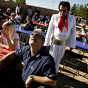 LAS VEGAS, NEVADA, November 12, 2007: Contestants from around the world, including this man from a Germany based race team, gathered in Las Vegas, Nevada on November 12, 2007 to race their pigeons in the Las Vegas Classic. Race participants watch the sky for the birds' return as Elvis works the crowd.