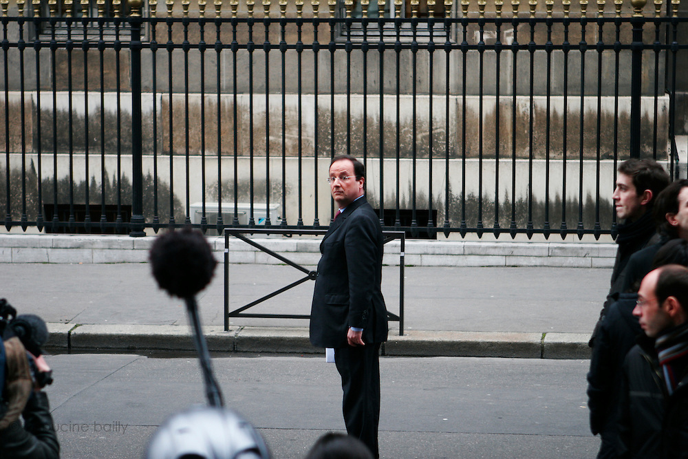 March 23rd 2006. Esplanade des Invalides, Paris, France..Francois Hollande, leader of the socialist parti,  watches the violent clashes that erupted during a student protest against the First Job Contract, known as CPE. The country's main student union condemned the violence, which police blamed on fringe groups of radicals and anarchists.