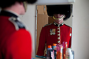 Mcc0023074 . Daily Telegraph..L Cpl Steven Scott checks himself in the mirror at Wellington Barracks  before going out on the parade ground...The Grenadier Guards preparing for Trooping the Colour in celebration of the Queen's Birthday on June 12 ..The Grenadier Guards only recently finished a six month tour of Helmand , Afghanistan on March 31...London 19 June 2010......Not AP.Not Reuters.Not PA.Not Getty.Not AFP.