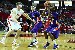 07 January 2012:  Jon Ekey gets past Denver Holmes as Kenneth Harris lines up his shot during an NCAA Missouri Valley Conference mens basketball game Where the Purple Aces of Evansville lost to the Illinois State Redbirds 75-73 in Redbird Arena, Normal IL