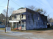Old Bryant Store in Money Mississippi site of the Emmett Till murder.the old Bryant Store in Money, MS. from 11/27.02.The old Bryant store it has stood the test of time but is in bad shape and decaying. The store is where Emmett Till a young black man from chicago who stopped in the store and whistled or cat called at the oweners blonde and white wife,Emmett was later found lynched and the men who were accused of the crime were found not guilty.The store owners was Roy Bryant it was his wife that was whistled at and Roy owned the store with his half brother J.W.Milam in 1955. Bryant and Milam were indicted for kidnapping and lynching Till but were later acquited of all charges.(photo/Suzi Altman) Photo ©Suzi Altman
