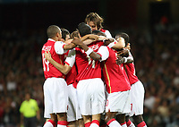 Photo: Chris Ratcliffe.<br /> Arsenal v FC Porto. UEFA Champions League, Group G. 26/09/2006.<br /> Alexander Hleb (obscured) of Arsenal celebrates scoring the second goal with Arsenal team mates.