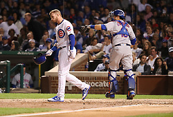 September 12, 2017 - Chicago, IL, USA - The Chicago Cubs' Ian Happ, left, reacts after striking out to end the third inning against the New York Mets at Wrigley Field in Chicago on Tuesday, Sept. 12, 2017. (Credit Image: © Chris Sweda/TNS via ZUMA Wire)