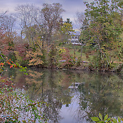 The proverbial hour on the hill.  I can only imagine the views from there over the canal.  It is an overcast autumn day, so the sky is also presenting some interesting details both directly in in the reflections with the many colors in the water