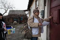 MSF doctor Svetlana Niekurasa  (r) and nurse Ksinia Tsvierkornova (l) on their rounds making home visits to patients in Debaltsevo.