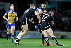 Leeds Rhinos Adam Cuthbertson is tackled by Hull FC's Chis Green (left) and Josh Bowden (right) during the Betfred Super League Semi-Final match at the Headingley Carnegie Stadium, Leeds.