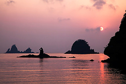 Sunset, Izu Peninsula, Nishiizu, Kamo District, Shizuoka Prefecture,<br /> Japan.<br /> <br /> In April windstorms blow sand from the deserts of China to the Sea Of Japan largely making ugly hazy skies however these problematic atmospherics worked for this sunset.