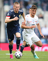 UEFA Euro 2020 Championship Group D match between Scotland v Czech Republic Hampden Park on June 14, 2021 in Glasgow, Scotland<br /> <br /> Scott McTominay chases for the ball ahead of Patrik Schick<br /> <br /> Credit: COLORSPORT/Ian MacNicol