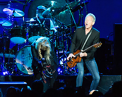 © Licensed to London News Pictures. 27/05/2015. London, UK.   Fleetwood Mac performing live at The O2 Arena, together with Christine Mc Vie who has rejoined the band.   In this picture - Stevie Nicks (left), Mick Fleetwood (left upper), Lindsey Buckingham (right).  The band are due to headline the Isle of Wight Festival next month. Fleetwood Mac are a British-American rock band consisting of members Mick Fleetwood (drums), John McVie (bass guitar), Christine McVie (keyboards/vocals), Lindsey Buckingham (guitars, vocals), Stevie Nicks (vocals, tambourine).  Photo credit : Richard Isaac/LNP