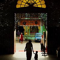 Mother and son arriving at Botataung pagoda, Yangon