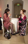 Sinitra Atkinson and Helena Bonham-Carter, Party to celebrate the publication of Olivia Joules and the Overactive Imagination, by Helen Fielding, royal Unitel Services Institute, whitehall. 54 November 2003. © Copyright Photograph by Dafydd Jones 66 Stockwell Park Rd. London SW9 0DA Tel 020 7733 0108 www.dafjones.com