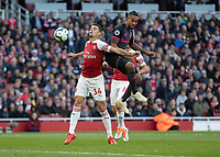 Football - 2018 / 2019 Premier League - Arsenal vs. Everton<br /> <br /> Granit Xhaka (Arsenal FC) calmly chests the ball back towards his goalkeeper under pressure from Theo Walcott (Everton FC ) at The Emirates.<br /> <br /> COLORSPORT/DANIEL BEARHAM