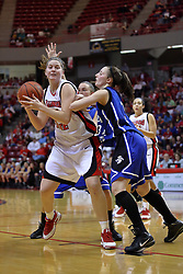07 February 2009:Nicolle Lewis takes a bit of abuse from Kelsie Cooley.  Illinois State increased their 1st place lead by beating 2nd place Indiana State by a score of 69-48. The Illinois State University Redbirds hosted the Indiana State University Sycamores on Doug Collins Court inside Redbird Arena on the campus of Illinois State University in Normal Illinois