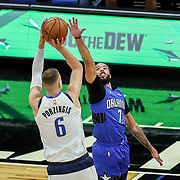 ORLANDO, FL - MARCH 01: Kristaps Porzingis #6 of the Dallas Mavericks attempts a shot over Michael Carter-Williams #7 of the Orlando Magic during the first half at Amway Center on March 1, 2021 in Orlando, Florida. NOTE TO USER: User expressly acknowledges and agrees that, by downloading and or using this photograph, User is consenting to the terms and conditions of the Getty Images License Agreement. (Photo by Alex Menendez/Getty Images)*** Local Caption *** Kristaps Porzingis; Michael Carter-Williams