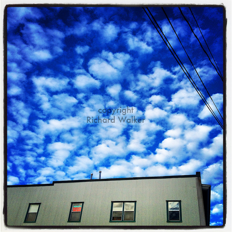 2014 July 19 - Blue sky, clouds over a building in Seattle, WA, USA. Taken/edited with Instagram App for iPhone. By Richard Walker